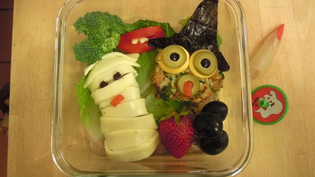 Mummy of cheese-wrapped raisin bread, turkey patty witch. Photo + Bento: Anna Mindess